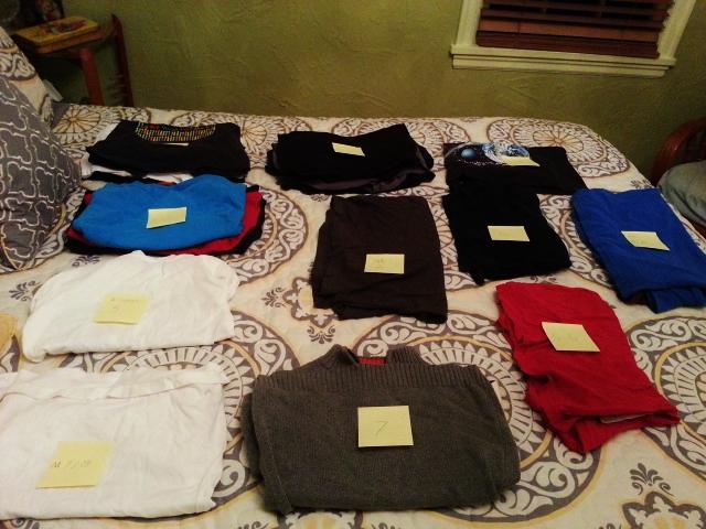 Nathan sorts shirts